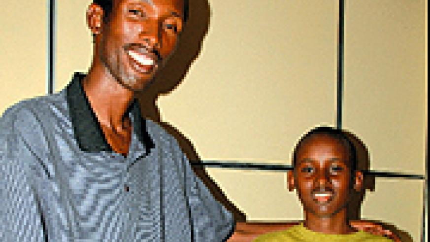 WELL DONE SON: Kigali Parents' Derrick Shema and his father Stephen Gasasira yesterday.