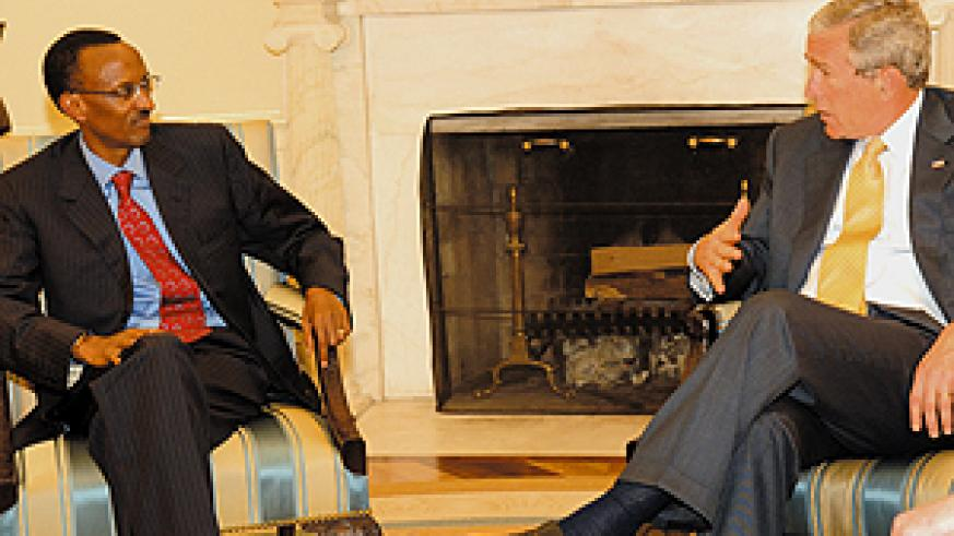 President Paul Kagame and President George Bush during the former's visit at the White House recently. (File Photo)