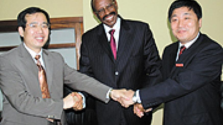 L-R: Ambassador Shuzhong, Mudidi and Dr Zhou Zeyang, the president of Chongqing Normal University after signing the deal on Wednesday at KIE. (Photo/J. Mbanda)