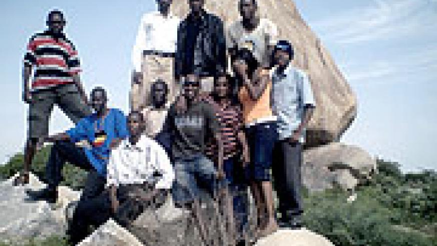 The author (seated with sun-glasses) with some of the students from EACSU, at one of Dodoma's large rocks.