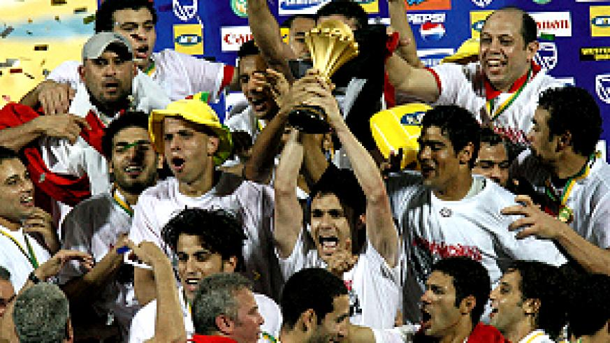 Egypt national football team captain Ahmed Hassan (C) flanked by his teammates holds the cup after defeating Cameroon 1-0 in the final of  the 2008 African Cup of Nations  yesterday. (AFP photo)