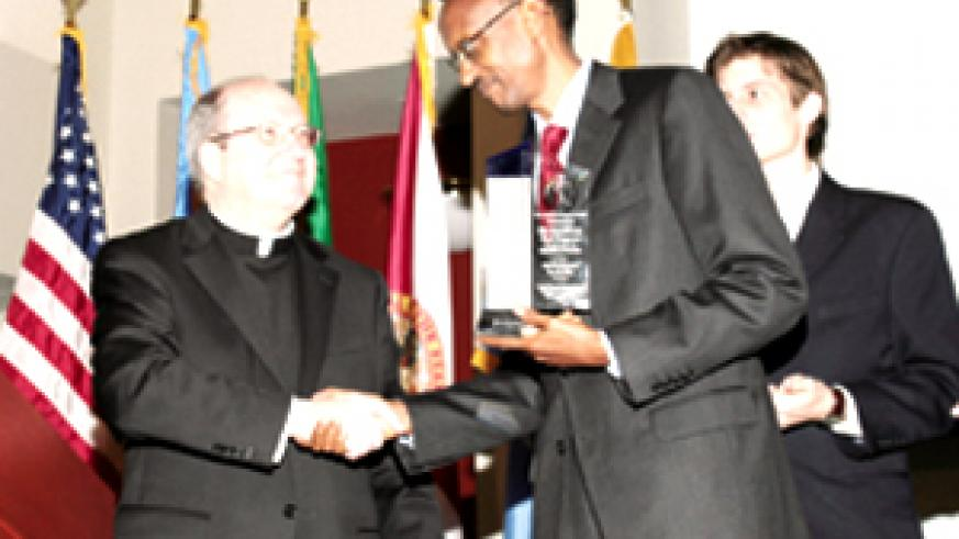 President Kagame receives the award from the Executive Director of the Claude Pepper Center, Mgr William Kerr, at Florida State University in the US yesterday. (PPU photo)