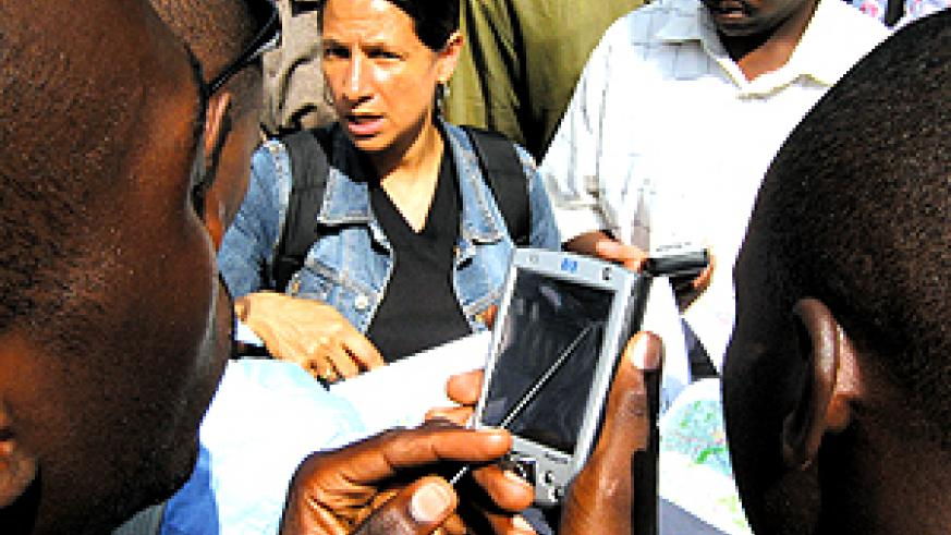 District officers learning how to use GPS;  middle is Dr Michelle Schilling of CGIS-NUR's forest mapping project. (Photo/E. Kwibuka)