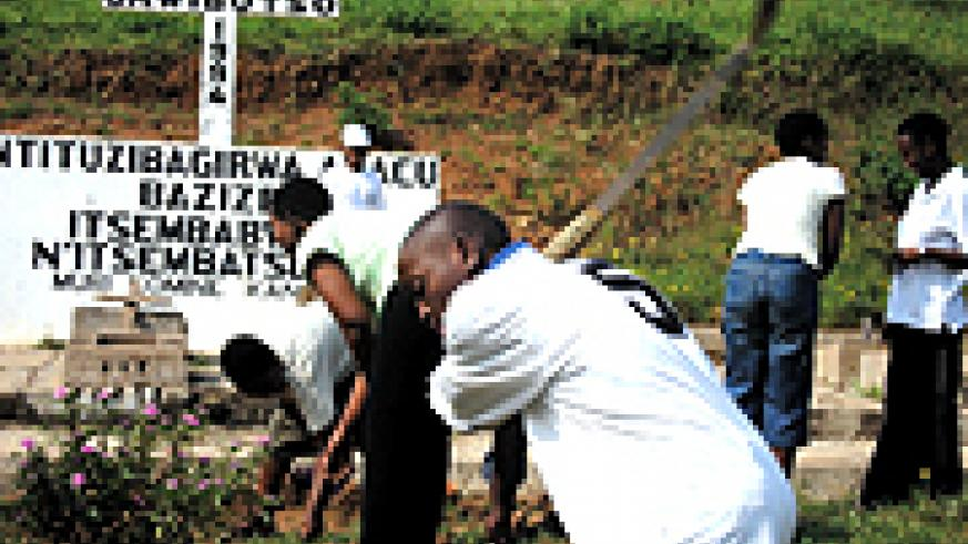 APADE students cleaning the Genocide memorial site on Sunday. (Photo/ S. Nkurunziza)