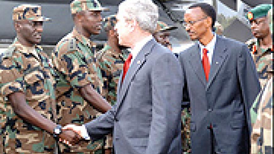 Bush and Kagame greeting members of the RDF who have previously served in Darfur, Sudan. (PPU photo)