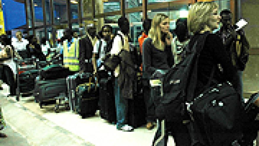 Passengers at Kigali International Airport. Many say the new policy is inconveniencing. (File photo)