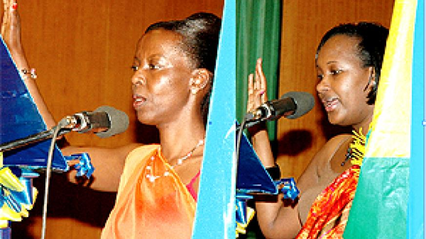 TAKING THE OATH: Ministers Mushikiwabo (L) of Information and Bihire of Infrastructure swear in yesterday at Parliamentary Buildings, Kimihurura. (Photo / G. Barya)