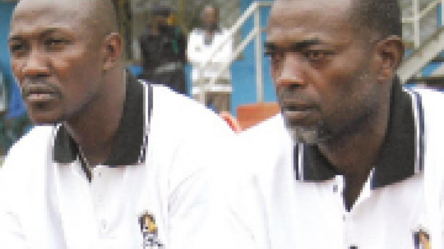 FIRED: Mfutila (R)  has been fired and his assistant Jean David Katotola Mukesa will remain in charge temporarily.