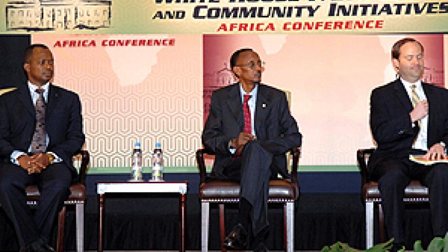 L-R: State Minister for Industry and Investment Promotion Vincent Karega, President Kagame and US' Jay Hein at Kigali Serena Hotel yesterday. (PPU photo)