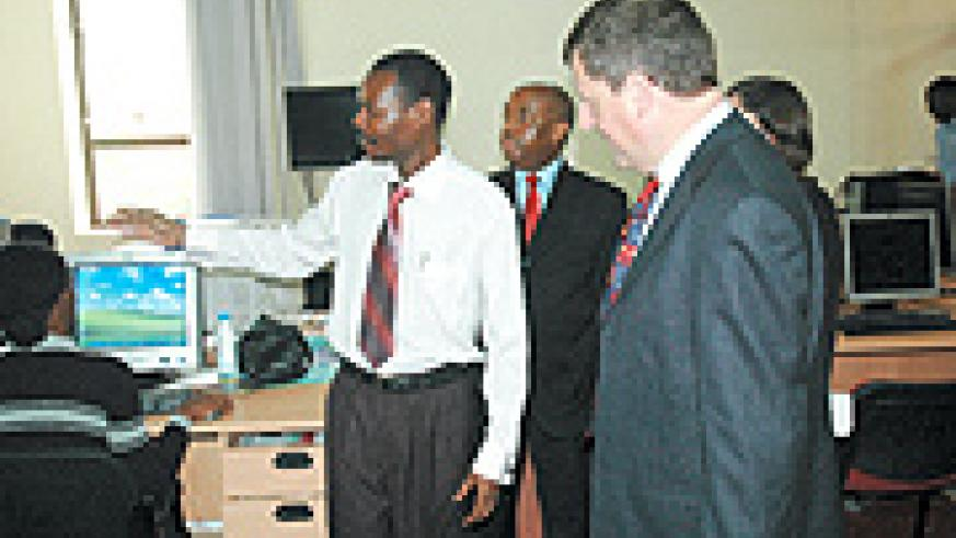 L-R: The New Times' Editor David Gusongoirye, Managing Director Joseph Bideri, Ambassador Cannon and Laurie Hunte, a British Embassy official in  the newspaper's newsroom yesterday. (Photo / J. Mbanda).