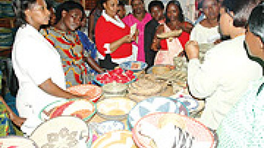Women displaying baskets at Gahaya Links.