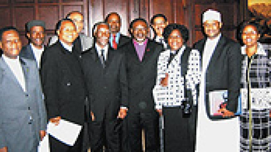 Thabo Mbeki poses with a African peace and human rights activists including Rwanda's Mufti Salleh Habimana back row with cap courtsessy.