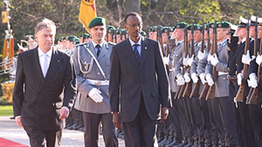 President Paul Kagame inspecting a guard of honour on arrival in Germany. He is accompanied by German President  Horst Koehler. (File photo).