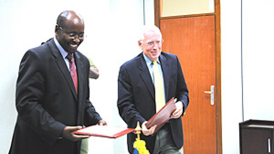 Finace minister Musoni with Ambassador MacRae after signing a $10.2 million grant to support elections. (Photo/E.Mucunguzi)