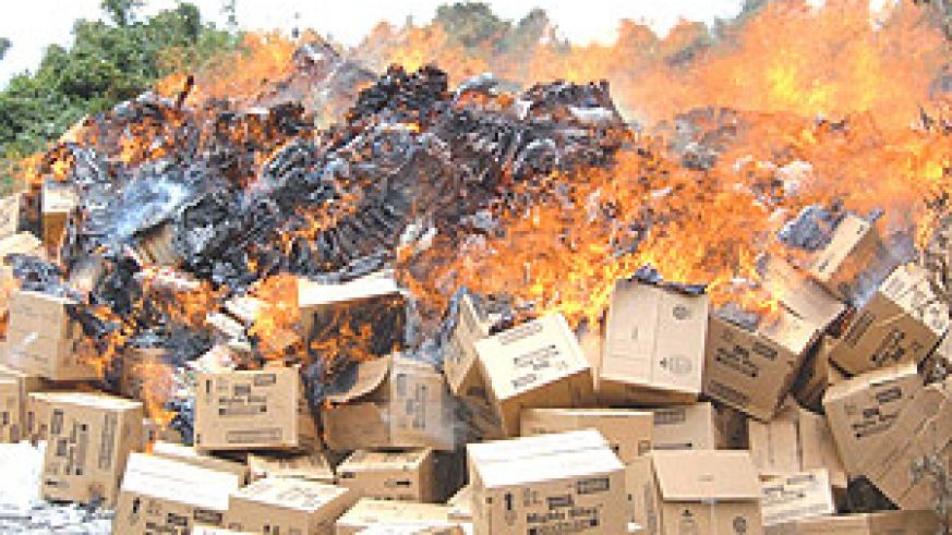Some impounded sub-standard goods which were set ablaze by the Rwanda Bureau of Standards. (File photo).