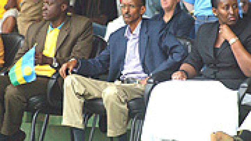 President Paul Kagame (C) flanked by the First Lady Jeannette Kagame (R)  and Sports and Culture Minister Joseph Habineza was in attendance to see Rwanda wallop Morrocco 3-1 on Saturday. (Photo / G. Barya).