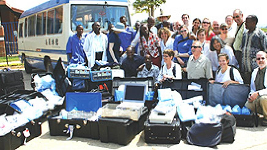 A group of medical personnel pose outside Kibagabaga Hospital with part of the Frw33m equipment they donated.