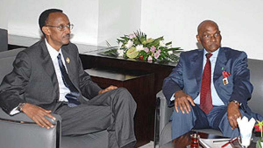 President Kagame in conversation with President Abdulaye Wade of Senegal at the AU Summit in Sharm El Sheikh, Egypt.