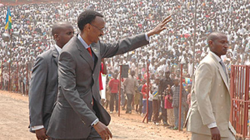 President Kagame waving to the multitude of people who attended Liberation Day celebrations at Muhanga Stadium yesterday.