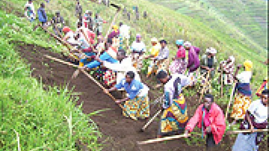 Residents dig terraces: The G.8 should help Africa modernise agriculture.