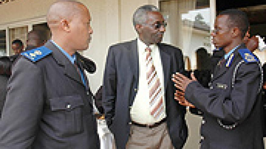 Assistant Commissioner of Police George Rumanzi (R) talks to NEC President Chrysologue Karangwa while Northern Region Police Commander Sup. Peter Hodari looks on. (Photo/ J. Mbanda)