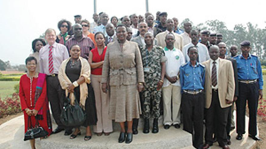 Acting police chief Mary Gahonzire (C) with participants of the workshop.