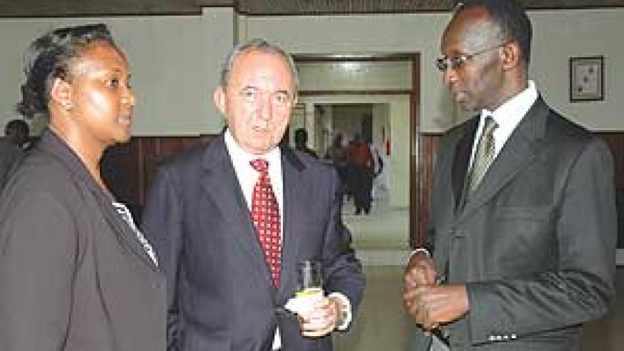 L-R Supreme Court Secretary General, Anne Gahongayire, Justice Richard Goldstone and the Vice President of the Supreme Court, Sam Rugege chat at the Supreme Court on Friday. (Photo/ G.Barya)