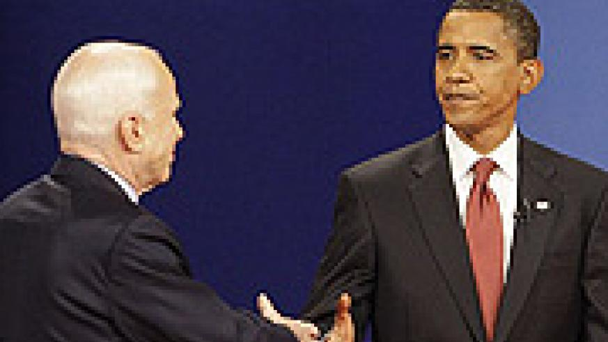 Barack Obama and John McCain shake hands at the start of their first televised debate, a crucial step in the election process.