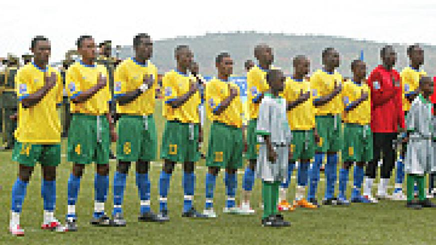 IN LINE OF DUTY:  Amavubi Stars  sing the national athem before their clash with Morocco's Atlas Lions in Kigali, which the hosts won 3-1.