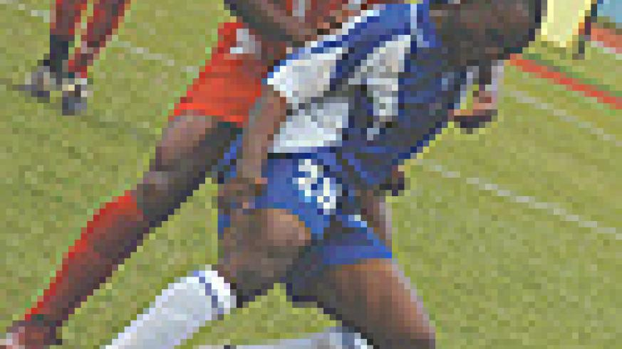 OUT: Abedi Mulenda's desired dream return to Rayon put him in trouble with the football governing body, Ferwafa. Here, the striker seen playing for the Blues in a Caf tie in 2005. (File photo)