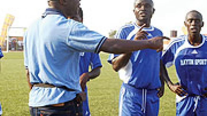 PLEASE HELP ME:  Rayon coach Raoul Shungu passing on new tactics to his players during a league match. The Congolese tactician badly needs a win under his belt to save his job.