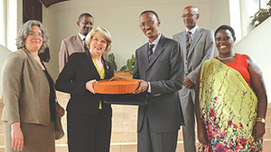 US Secretary of Education Margaret Spellings receives a gift from President Paul Kagame yesterday at Village Urugwiro.(Photo /J. Mbanda)