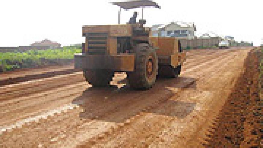 A tractor grading Kabeza road. KCC wants to raise funds through a municipal bond to finance infrastructure development. (File photo)