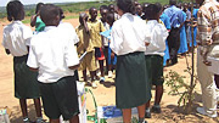 Green Hills Academy pupils giving scholarstic materials to their Mbyo Primary School counterparts. (Courtesy Photo).