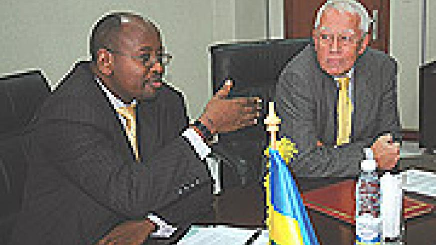Finance Minister James Musoni makes a statement before the signing,  Right is Head of EU Commission to Rwanda David MacRae. (Photo/ J Mbanda).