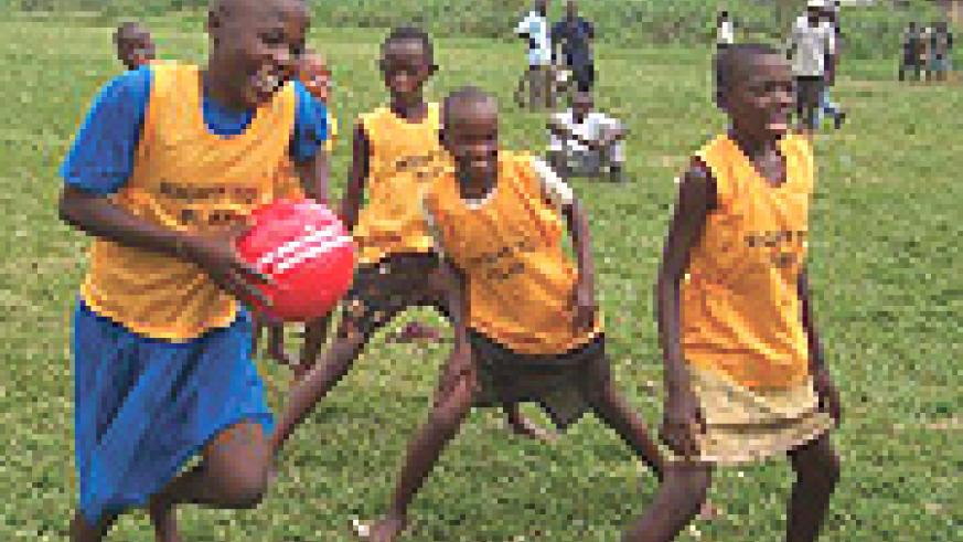 OUR RIGHT : Children enjoy their right to play with ball offered by Right to Play. (Courtesy Photo).