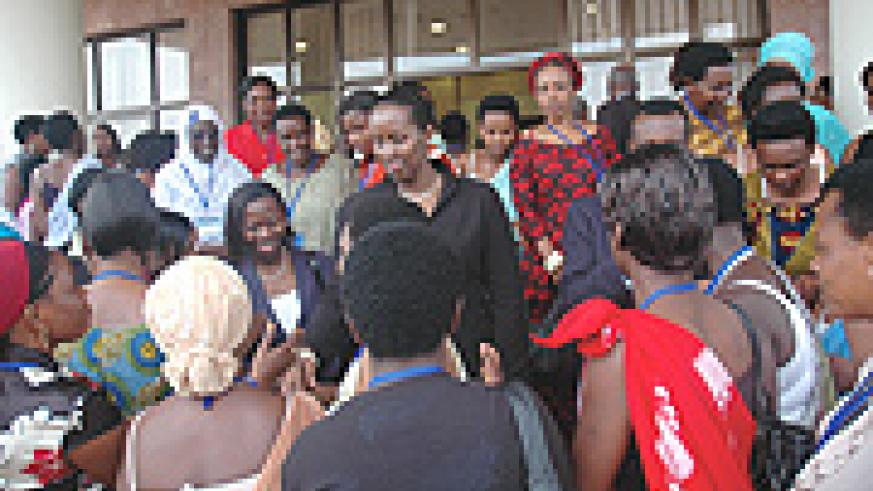 First Lady Jeannette Kagame (C) greets women after openning the National Roundtable of Women Entrepreneurs at Prime Holdings yesterday. (Photo J. Mbanda).