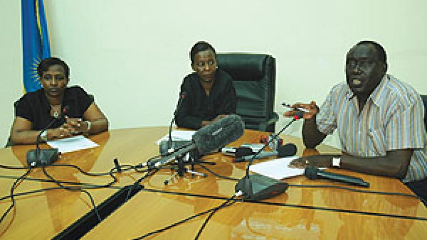 Justice Minister Tharcisse Karugarama (R)  responds to questions from journalists as Ministers Louise Mushikiwabo (C) and Rosemary Museminali look on. (Photo/J. Mbanda)