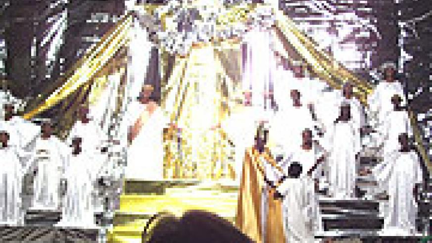 Scene depicting Jesus taking a lady to Heaven as angels welcome her to Heaven's gates.