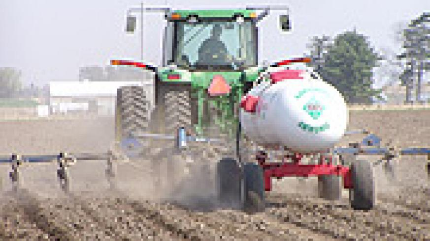 A farmer applying  fertilizers.