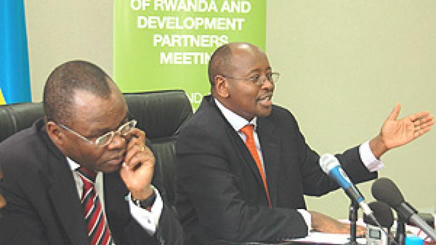 Minister of Finance, James Musoni stressing a point at a press conference while UN Resindent Coordinator, Aurelien Agbenonci, listens. (Photo/G.Barya).