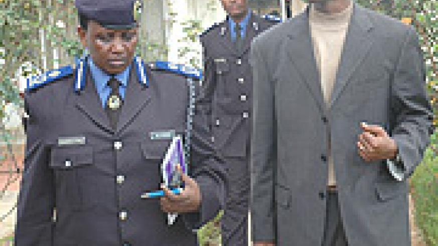 The acting Commissioner General of the Police Mary Gahonzire and Internal Security Minister Musa Fazil Harerimana .
