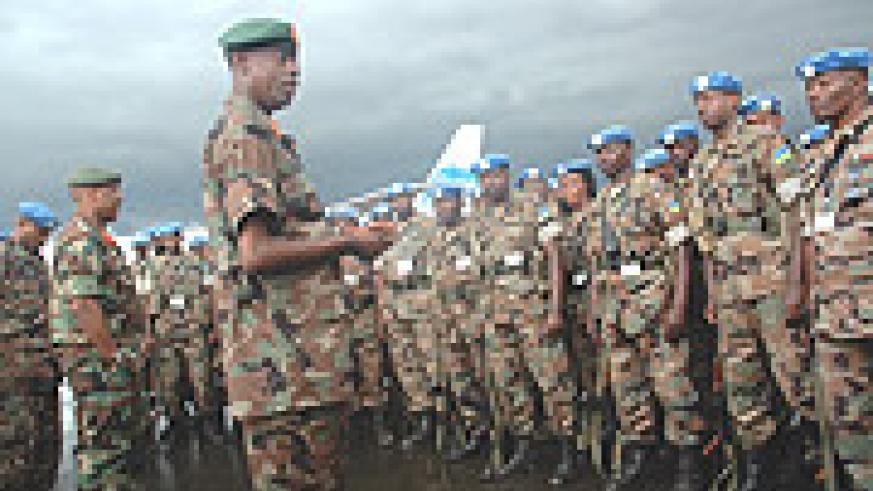General Kabarebe addresses  troops on their arrival at Kigali International Airport from Darfur. (Photo File).