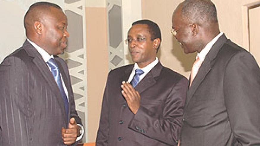 Senate President Vincent Biruta (C) shares a light moment with DR Congo Speaker Vital Kamerhe (L) and Burundian Senate President Gervais Rufyikiri at the conference yesterday. (Photo/ G. Barya).
