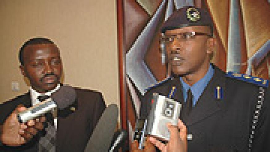 Chief Supt. Joel Ndahiro (R) and Isaie Bagabo respond to questions from reporters at Serena Hotel. (Photo/ J .Mbanda).