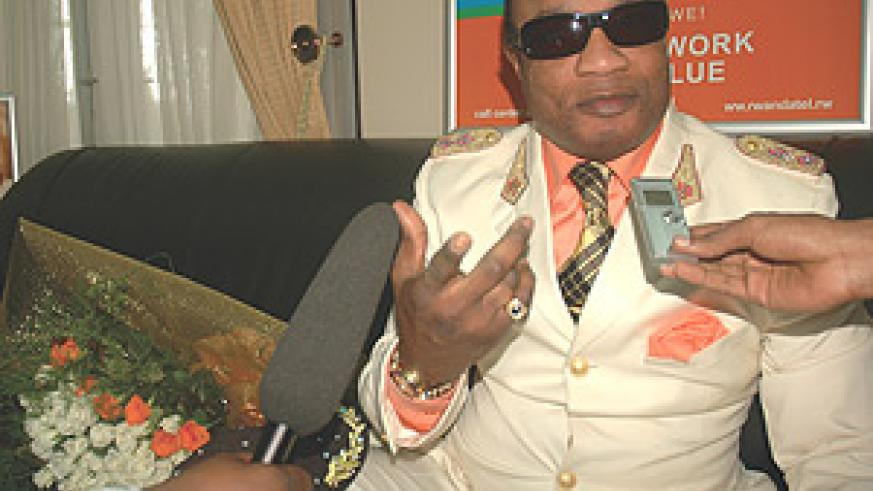 Koffi Olomide speaks to the Press shortly after arriving at  Kigali International Airport.
