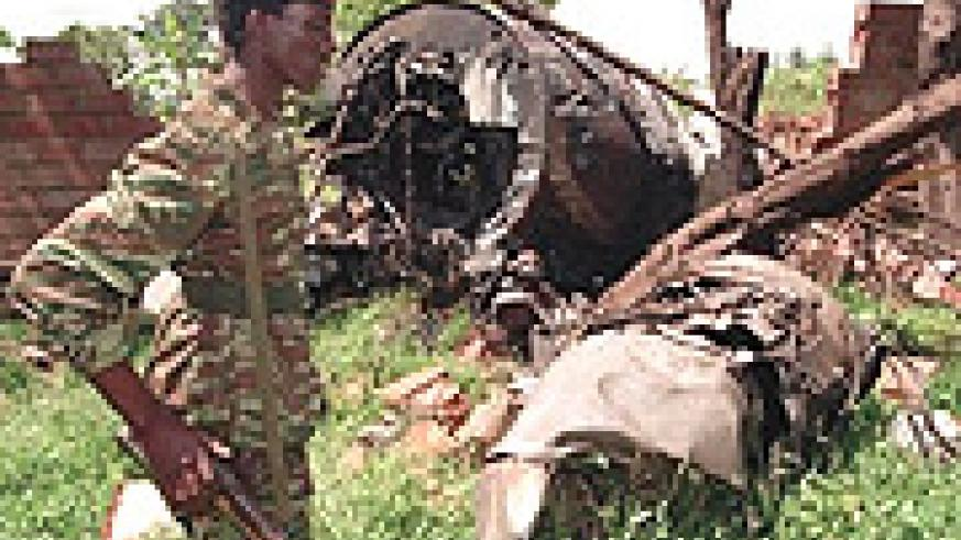A soldier walks by the wreckage of the plane carrying President Habyarimana.