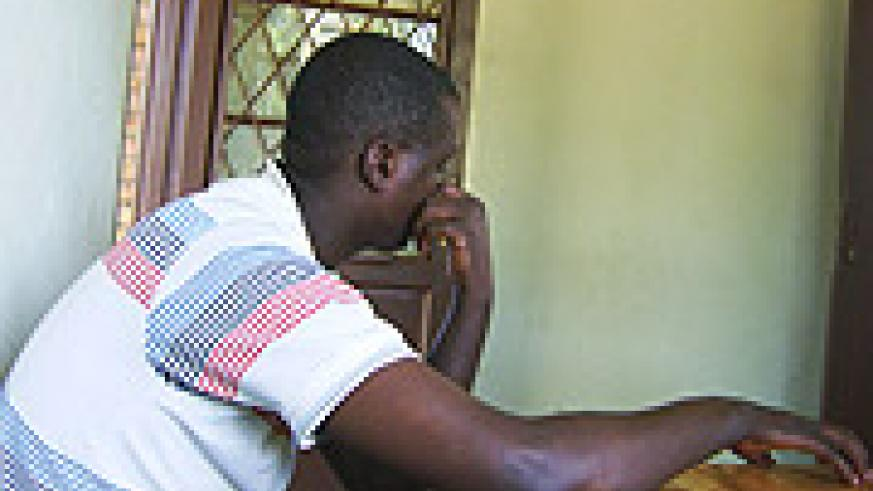 Justin Mutabazi shying away from the camera at Remera police station on Monday. (Photo/ E Mutara)