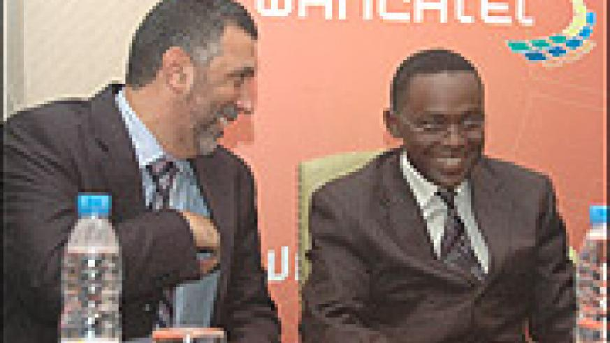 Abdulbaset Elazzabi, the Chairman, Board of Directors of Rwandatel and ICT Minister, Romain Murenzi. (File photo)