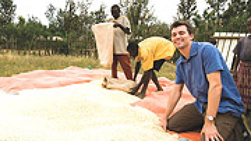 Bumper Harvest;Josh at a weighing station for the maize crop produced at the Mayange Millenium Village.